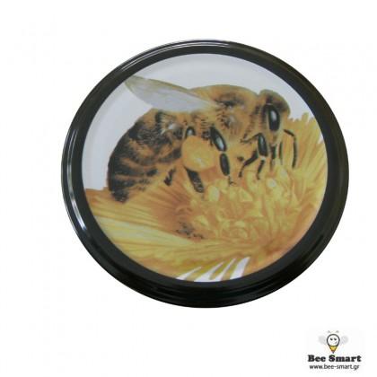 Καπάκι μαύρο μέλισσα μεγάλη σε λουλούδι