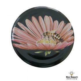 Καπάκι μαύρο μέλισσα μικρή σε λουλούδι